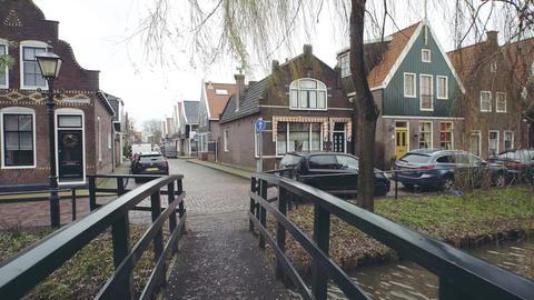 VOLENDAM, NETHERLANDS - DECEMBER 30, 2017. POV walk along small bridge in the Footage