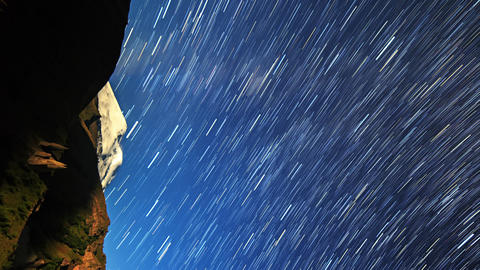 Vertical video. Stars draw lines and clouds over Mount Elbrus. Night landscape. Footage