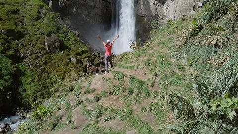 Elbrus region. Girl on the background of a waterfall. The Sultan waterfall on Footage