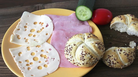 Sesame seed baguette on wooden plate with ham,cheese Image