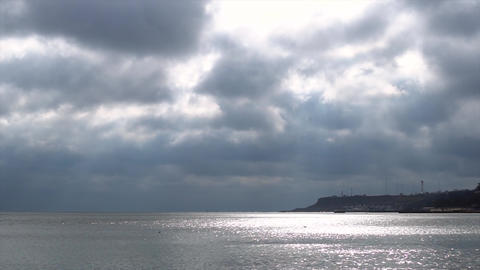 Cloudy sky above the sea coast time-lapse Filmmaterial