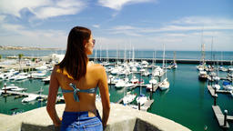 Brunette Girl Watching Yacht Port And Enjoying Ocean Breeze In Portugal Image