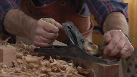 Cabinet Maker Planes Solid Wood in his Workshop Bild