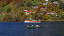 Rowing boat and excursion boat at lake Tegernsee Footage