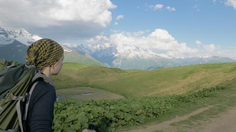 Girl hikes in the mountains - Koruldi lakes area, Mestia,Georgia Archivo