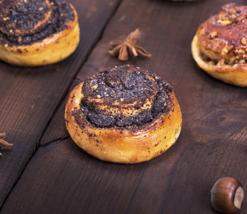 round poppy and nut buns on a brown wooden table Photo
