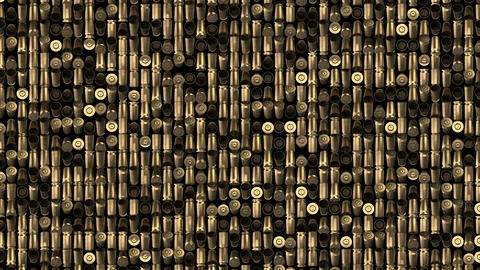 a continuous layer of revolving bullets. military background. seamless loop Archivo