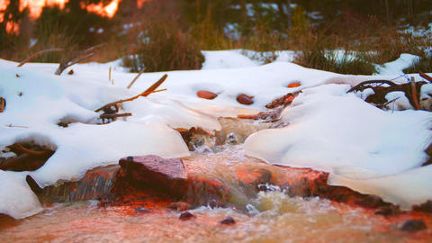 Red river from the melting snow snow Slow motion Footage