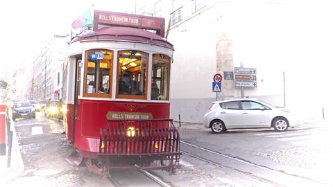 LISBON, circa 2017: Old tram passing by in the old town of Lisbon Portugal Live Action