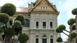 Thailand Bangkok 067 royal palace, part of grand palace between exotic trees Footage