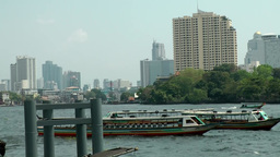 Thailand Bangkok 085 Chao Phraya River, boats and buildings of downtown Footage