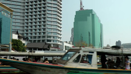 Thailand Bangkok 105 Chao Phraya River, old swinging boats and modern buildings Footage
