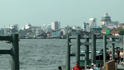 Thailand Bangkok 110 pier at Chao Phraya River and the modern city Footage
