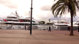 Large yachts at port, long slide shot along promenade, walk on waterfront Footage