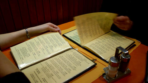 People in a restaurant reading menu Live Action