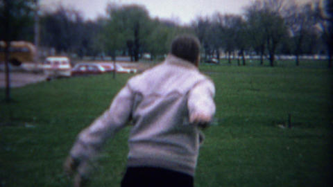 1962: Teenage boy dad toss horseshoes clowning around at park Footage