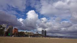 Nimbus and rainy clouds over city and empty beach, cool weather at Barcelona Footage