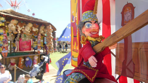 A punch puppet waving a stick in front of EU flags Footage