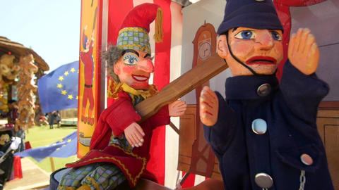 Punch and policeman puppet with EU flags in the background Footage