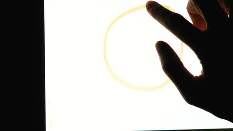 Hand draws on the tablet a symbol of peace and love, hippie sign, in the dark Footage
