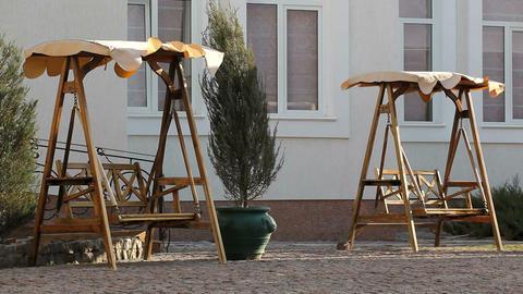 wooden swing in the wind Archivo