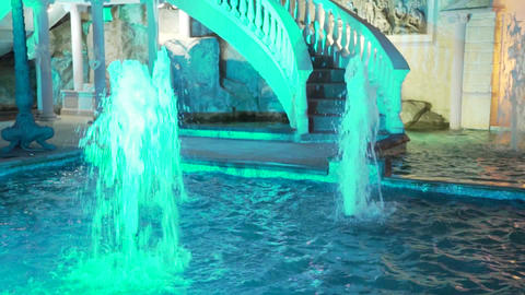 Beautiful colorful fountain near the restaurant at night Footage