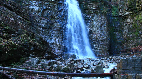 waterfall with water falling from a cliff Footage