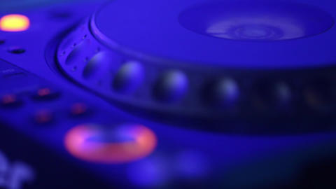 Remote DJ close-up. Turntables, buttons and men's hand Footage