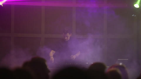 Professional DJ works close-up on the soundbar at a nightclub party. Light music Live Action