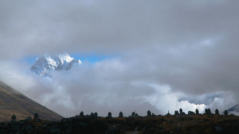 The movement of clouds over the mountain Ama Dablam Footage