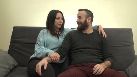 Couple Talking and Laughing on the Couch 2 Footage