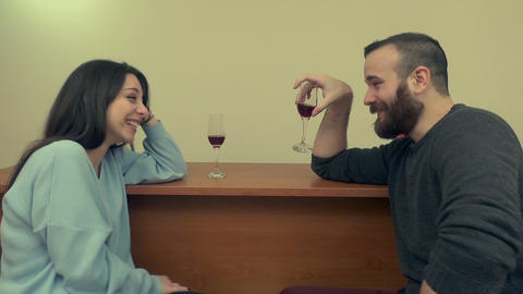 Couple Drinking Wine and Laughing 1 Image