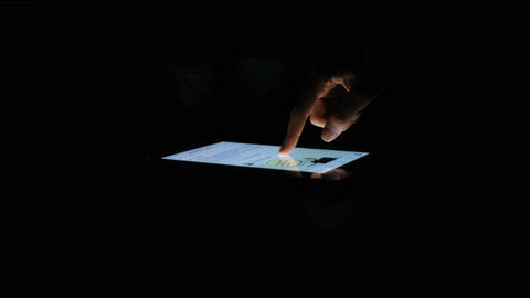 Hand puts like on the tablet in the dark, social networking, close-up, 4K Footage