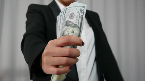 Business Woman Displaying a Spread of Cash Footage