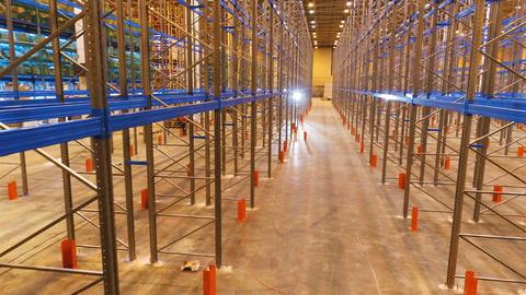 Assembled Metal Shelves in Empty Modern Warehouse Footage