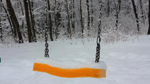 Children's swing in the snow Footage