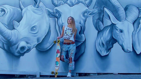 Young fashion sensual woman leaned against the wall with graffiti Footage
