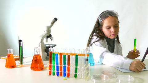 Young scientist does experiment Image