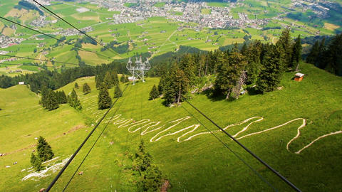 Footage of beautiful green hills and mountains in Switzerland Alps Footage