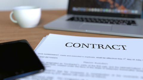 Copy of contract on the desk Archivo