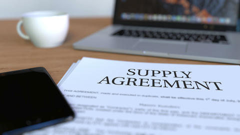 Copy of supply agreement on the desk Image