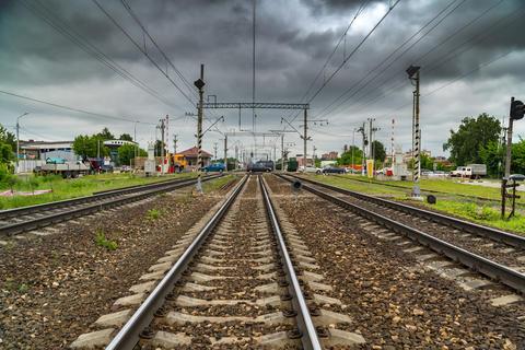 Cars cross the railroad tracks on the asphalted railroad crossing Fotografía