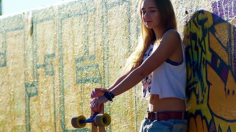 Longboard California, Beautiful young girl with longboard in sunny weather GIF