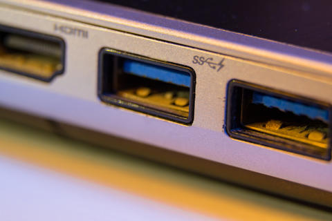 Closeup of fast blue USB 3 ports in a laptop フォト