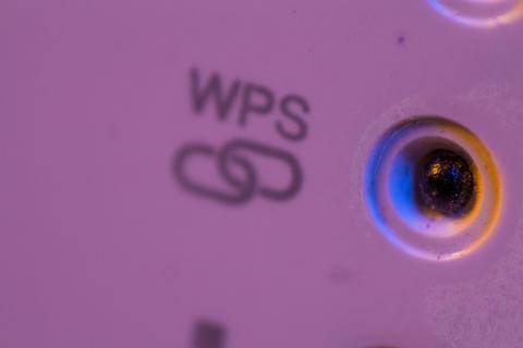 Macro closeup on WPS symbol signal connection status led light フォト