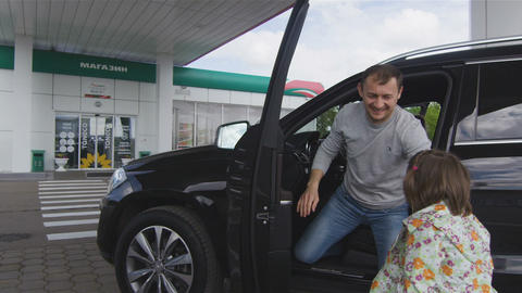 Jeep Drives to Fuel Station Family Goes to Shop Closeup Image