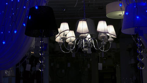 4K Chandeliers Flashing Lamps in Store at Night Footage