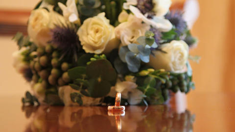 bridal bouquet and wedding rings Live Action