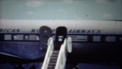 1954: Pilot Confidently Standing On Pan American Airlines Airplane stock footage