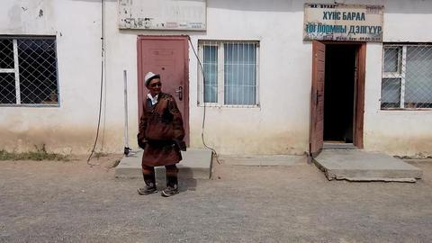 Mongolian Man in Town Footage